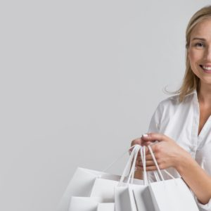 happy-woman-holding-lots-shopping-bags